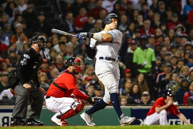 Slide 26 of 47: BOSTON, MA - OCTOBER 05:  Aaron Judge #99 of the New York Yankees singles in the seventh inning against the Boston Red Sox in Game One of the American League Division Series at Fenway Park on October 5, 2018 in Boston, Massachusetts.