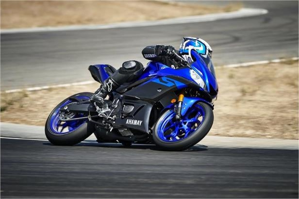 a man riding a motorcycle on the side of a road: 2019 Yamaha YZF-R3