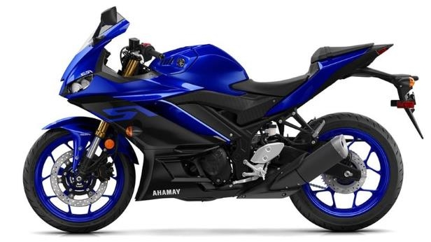 a motorcycle parked in front of a blue wall: 2019 Yamaha YZF-R3