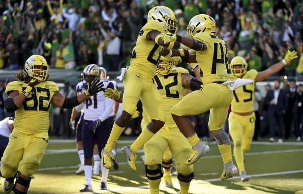 EUGENE, OR - OCTOBER 13:  Running back CJ Verdell #34 of the Oregon Ducks celebrates with teammates after scoring the winning touchdown in overtime of the game against the Washington Huskies at Autzen Stadium on October 13, 2018 in Eugene, Oregon. The Ducks won the game 30-27.  (Photo by Steve Dykes/Getty Images)