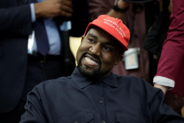 e4d7aa8dce7 Rapper Kanye West is seated while meeting with President Donald Trump and  others in the Oval