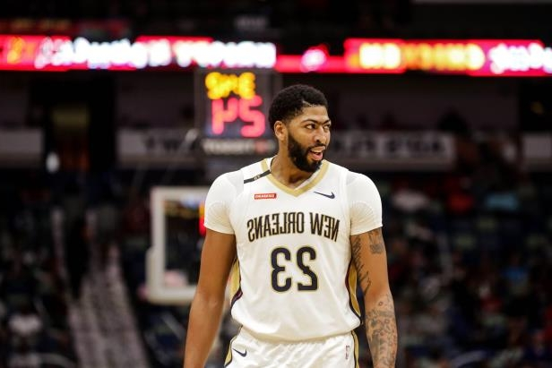 3b75be77e82 Anthony Davis holding a basketball  New Orleans Pelicans forward Anthony  Davis against the Toronto Raptors