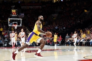 See LeBron James' first points as a Laker, which came on a thunderous dunk