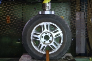 Watch as these wheels are crushed in a hydraulic press