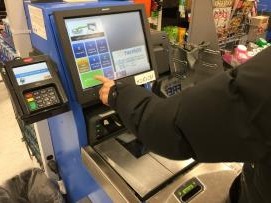 Money: Walmart ramps up self-checkout, scales down 'scan and