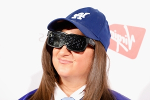 Honey G is UNRECOGNISABLE as she ditches her trademark gangster cap and glasses for sophisticated new look and career as an estate agent