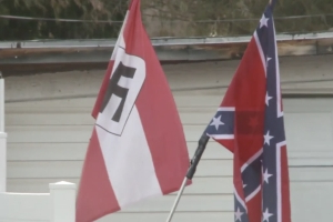 Protesters march to Colorado home that raised Nazi and Confederate flags