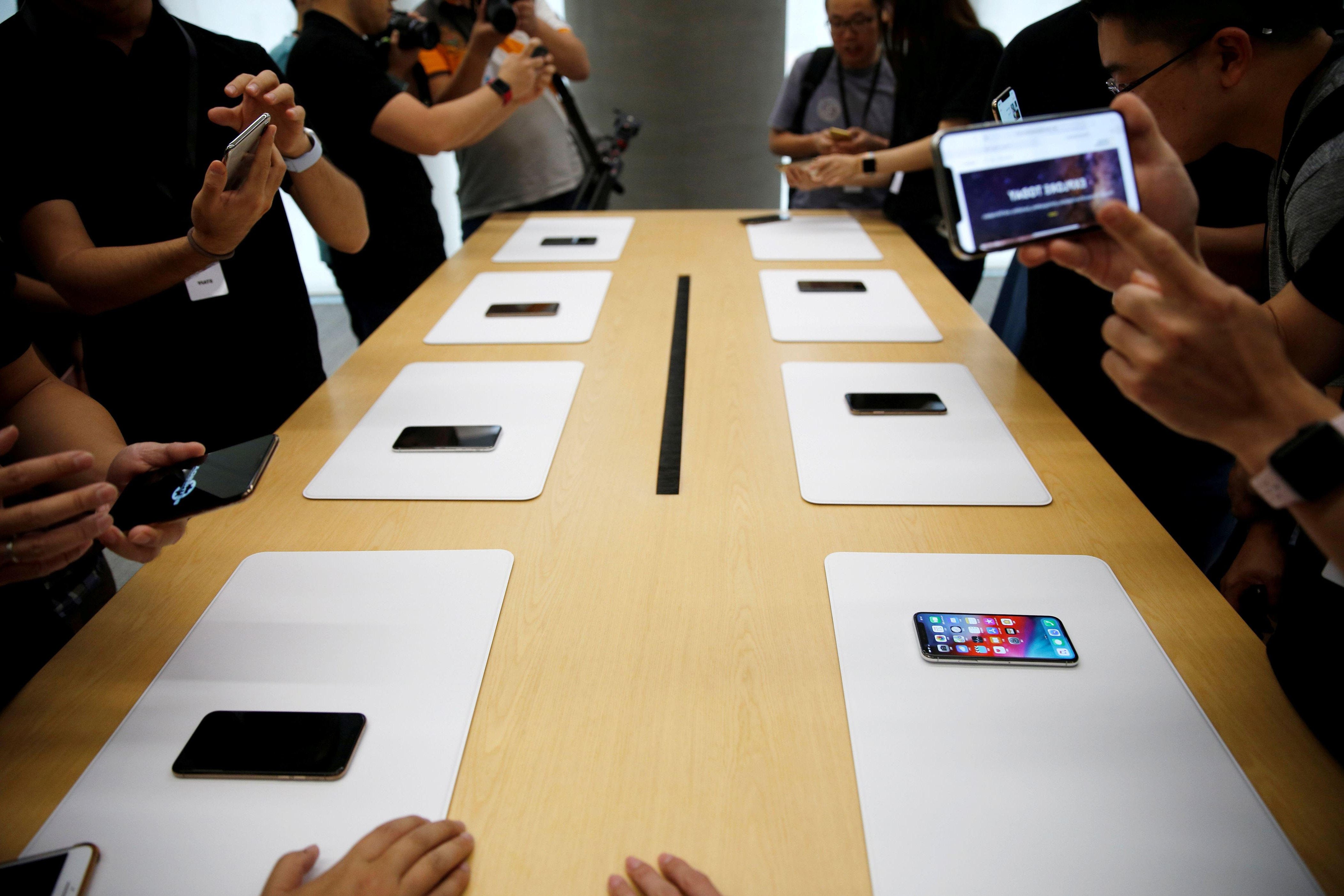 Apple cuts production orders for all three new iPhone models - WSJ