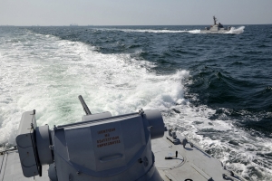 Ukraine says 2 navy vessels hit by Russian fire