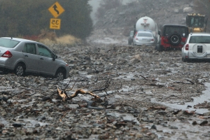 Thousands evacuated as flash floods hit fire-ravaged California