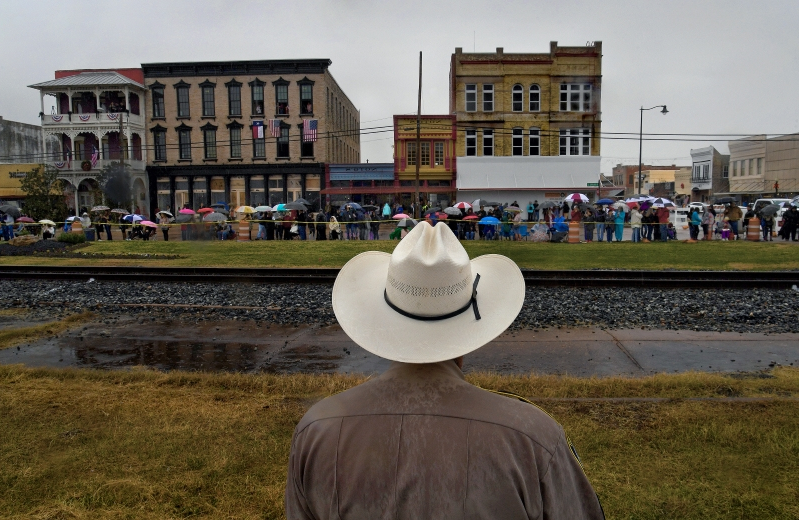 Small Texas town treasures historic moment as Bush's funeral train travels through