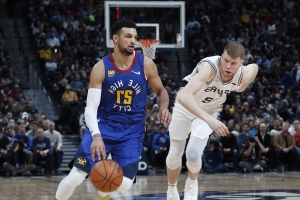 Nuggets keep rolling at home, hold off Spurs 102-99