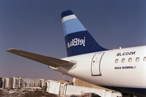 Unruly JetBlue passenger forces emergency landing, spits on arresting officer's face