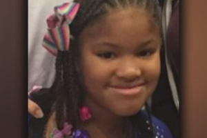 Community holds vigil as police hunt for killer of 7-year-old girl