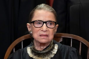 Ginsburg misses Supreme Court arguments for the 1st time