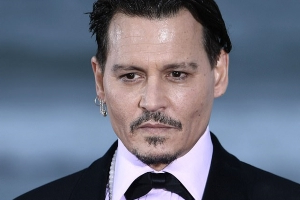 Johnny Depp settles lawsuit with two former bodyguards who claimed they were exposed to unsafe conditions, overworked and underpaid