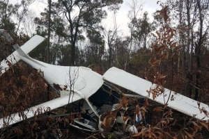 Pilot walks from Queensland crash that tore wing from plane