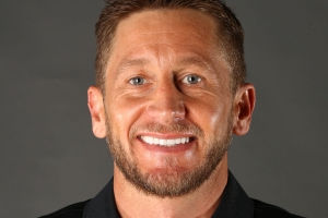 Phoenix Mercury fire assistant coach Todd Troxel after he's charged with assault