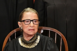 Ginsburg's recovery 'on track' but will miss more U.S. high court arguments
