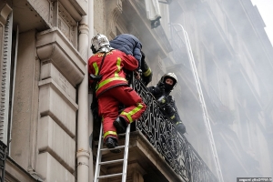 Huge explosion rocks Paris leaving nine people seriously injured as fire crews haul locals from blazing buildings amid scenes of destruction caused by 'gas leak in bakery'