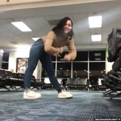 Law student who missed her flight embraces a four hour wait at the airport by dancing around the terminal- and even her cat joins in
