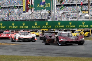 The Latest: Penske entries bobble during long Rolex yellow