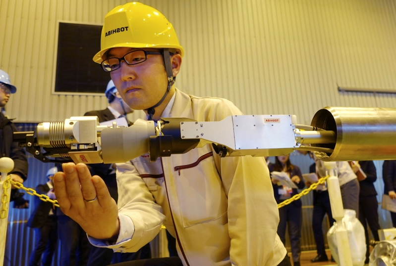 Image result for Toshiba unveils robot to probe melted Fukushima nuclear fuel
