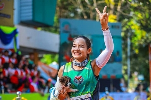 Bet she was dog-tired! Marathon competitor runs 19 miles carrying a PUPPY after finding it in the road during her race