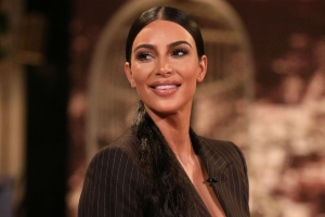 Kim Kardashian Rocks Curly Sideburns -- See the Outlandish New 'Do