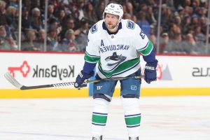 Canucks' Edler stretchered off after falling awkwardly, hitting face on ice
