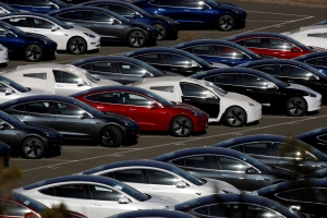 Tesla cuts Model 3 price for second time this year