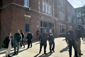 Baltimore high school hall monitor shot by visitor, suspect arrested