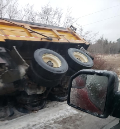 How icy is it on Nova Scotia roads? Even salt trucks can't stay upright
