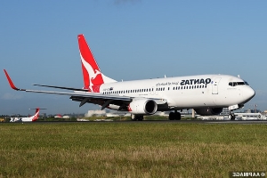 Passengers forced to evacuate from an overheating Qantas plane via slides after the flight is diverted to Cairns