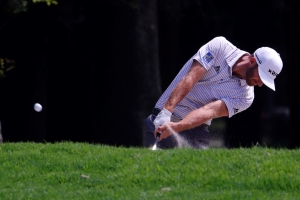 Johnson overcomes tree trouble for 4-shot lead in Mexico