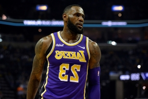 02fa8579a76b Sport: Proud dad LeBron wears Bronny James shirt to Lakers ...