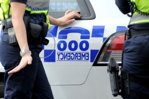 Sixth person charged over attack on police