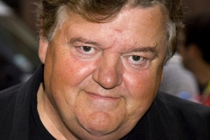 Harry Potter star Robbie Coltrane is seen in a wheelchair after being left in 'constant pain' for years amid his ongoing osteoarthritis battle
