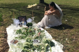 She lost her fiancé to gun violence. The day after she was set to be married, she visited his grave in her wedding dress
