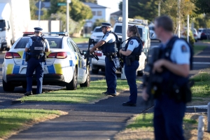 The moment a hero cop drags the suspected white supremacist shooter from his car in a dramatic roadside arrest just minutes after the Christchurch mosque massacre