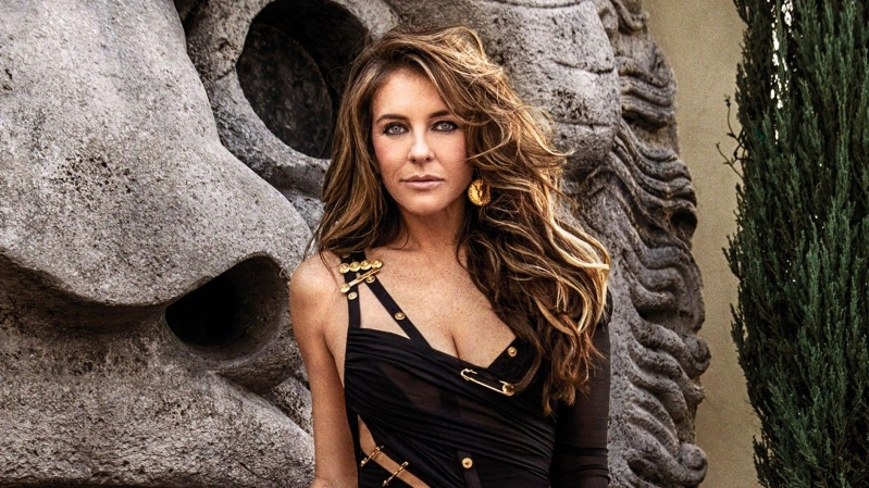 716386feddc Elizabeth Hurley Says She Was 'Unprepared' for Reaction to Her Versace Pin Dress  as