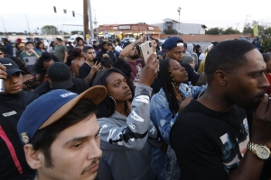Hundreds gather at site where Nipsey Hussle was fatally shot to mourn rapper