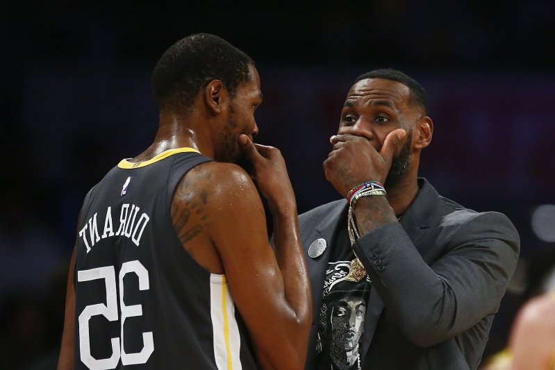 Kevin Durant, LeBron James have private discussion on court during timeout