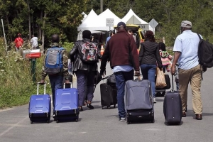 Refugee advocates 'shocked and dismayed' over asylum changes in budget bill