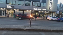 Man arrested after vehicles set on fire on Edmonton's Whyte Avenue Friday night