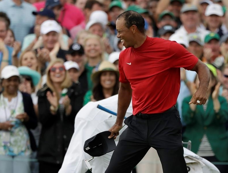 Tiger Woods' red mock turtleneck popular with golf fans following Masters win