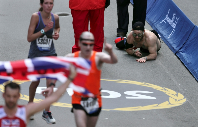 A Marine heroically crawled to the finish line of the Boston Marathon and it was awesome