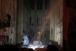 The cross still stands and votives remained lit. Signs of hope out of the Notre Dame cathedral fire
