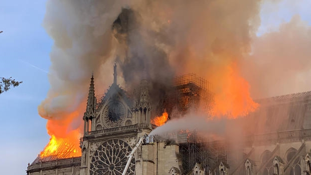 Video shows people singing hymn to honor Notre Dame as it burned