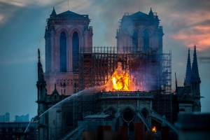 Notre Dame fire started at the center of the cathedral's roof, police source says
